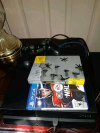 black Sony PS4 console with controller and game cases Toronto, M3N 3A1