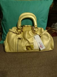 women's gold faux leather handbag.