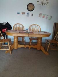 brown wooden oval 4 piece dining table set