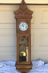 Oak grandfather wall clock, chimes ring every 30 min. Key wound Claremont, 91711