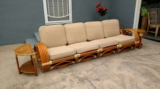 brown wooden framed and white fabric padded sofa