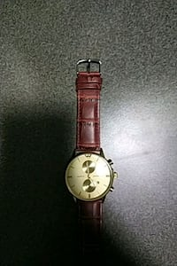 round gold-colored analog watch with brown leather strap Calgary, T3J 5M7