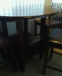 Round brown wooden table with 3 chairs Oxnard, 93030