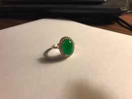 Beautiful ring with jade in the middle and Swarovski crystals around