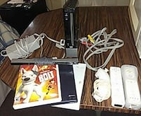black Nintendo Wii game console with assorted white game controllers and games Homosassa, 34446