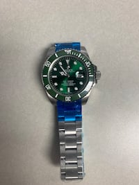 Green and silver Watch: not for free