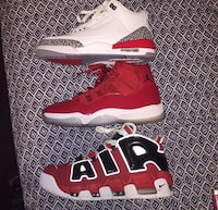 pair of red-and-white Nike basketball shoes Houston