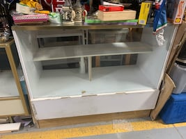White wooden and glass display cabinet