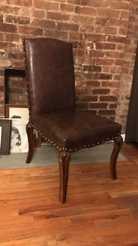 Brown leather parson chair with cabriole leg