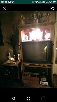 black CRT TV with brown wooden TV hutch Fernandina Beach, 32034