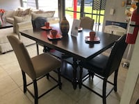 rectangular black wooden table with four chairs dining set Houston, 77084