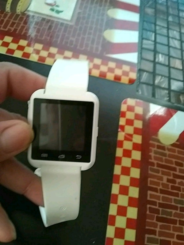 White smart/Bluetooth watch
