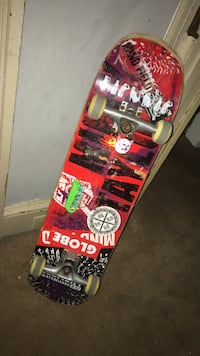 red and black skateboard