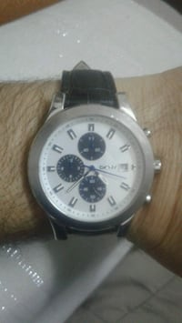 round silver chronograph watch with black leather  Tersane Mahallesi, 35240
