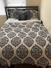 Full queen bed with mattress and box spring