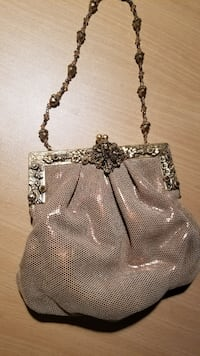 silver-colored leather crossbody bag 220 mi