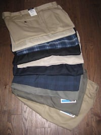 BRAND NEW men's shorts by Haggar Izod Dockers and Greg Norman size 36 only - $15 each Calgary, T2Y 3J8