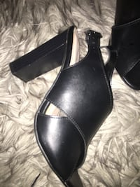 Pair of black leather open-toe sandals Coquitlam, V3K 6Y8