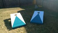 two white-and-blue corn hole