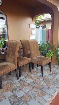 Four tufted brow padded chairs Aventura, 33180