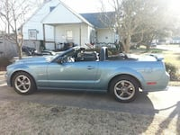 blue and black convertible coupe 30 km