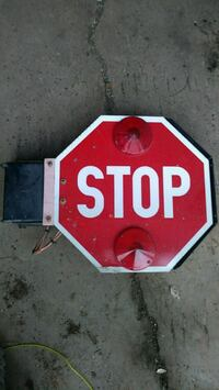 Electric swing out stop sign for ice cream truck