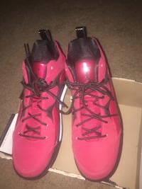 pair of red Air Jordan basketball shoes with black box