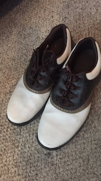 black-and-white leather golf shoes