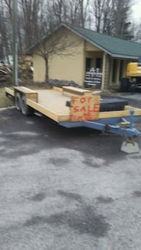 brown flatbed trailer 268 mi
