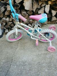 toddler's white and pink bicycle with training wheels Havelock, 28532