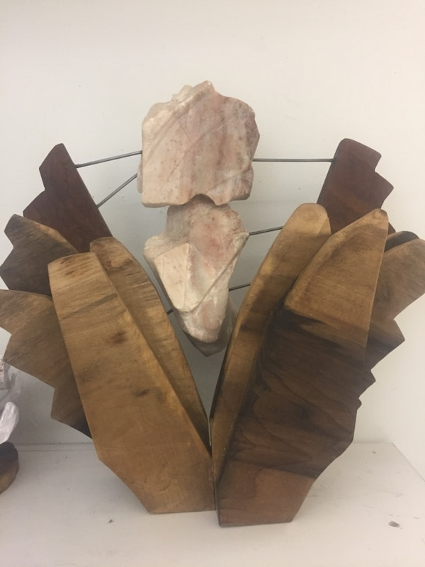 Wood and stone sculpture.