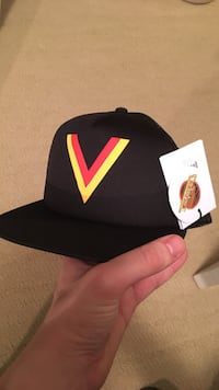 black, red, and yellow cap
