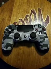black and white camouflage Sony PS4 controller