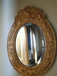 Antique ova gold color tin over wood framed mirror Baltimore, 21209