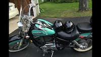 teal and black touring motorcycle Rochester, 14626