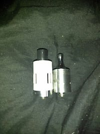 two black and white atomizer