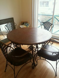 round brown wooden table with four chairs dining s Kelowna, V1X 6G9