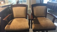 two brown wooden framed brown padded armchairs 47 km