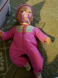baby doll in pink footie pajama
