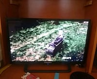 black flat screen TV with Remote.. Houston, 77080