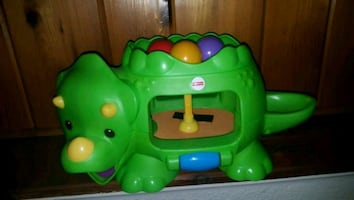 green Fisher-Price ride on toy