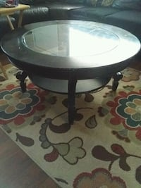 round black wooden base glass top table New Orleans
