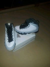 pair of white-and-black Nike basketball shoes Lewisville, 75077