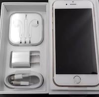 silver iPhone 6 with EarPods and charger Toronto, M5T 1B7