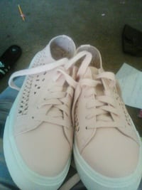 pair of pink-and-white low tops 22 mi