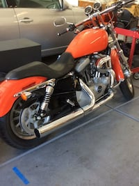 Orange and black cruiser motorcycle