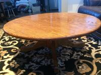 Oval brown wooden coffee table Calgary, T2J 2W6