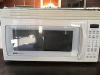 white General Electric microwave oven 838 km