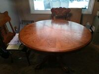 Solid wood round table with 4 cane seat chairs Milwaukie, 97267