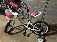 white and pink bicycle with training wheels 34 km